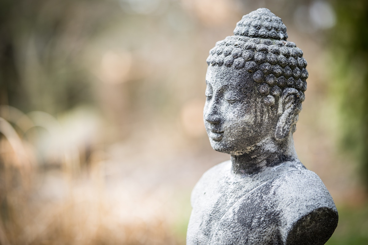cement buddha statue morning meditation