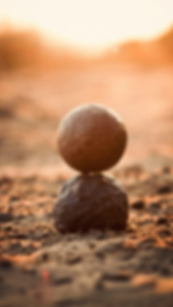 blurry image of stones stacked on sand how do you meditate